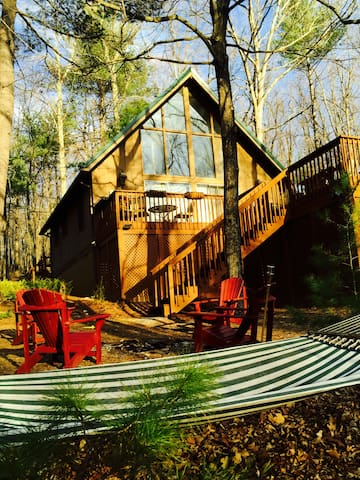 Enjoy a fire in the fire pit or relax on the hammock.