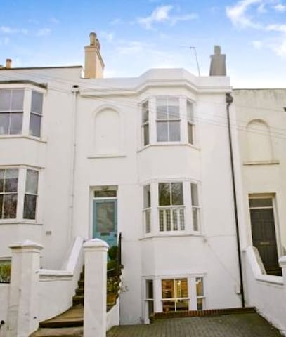 3 storey Victorian terrace with a small parking space