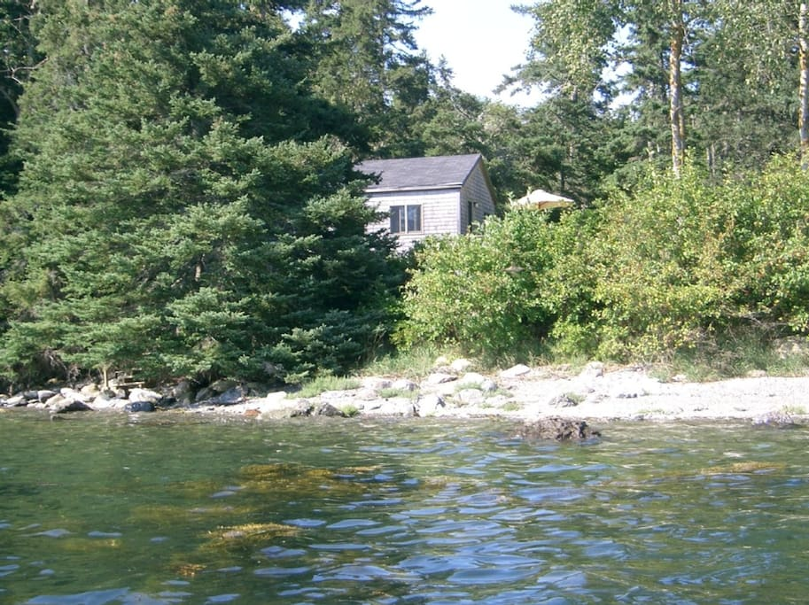 view of cottage from harbor — rent a kayak
