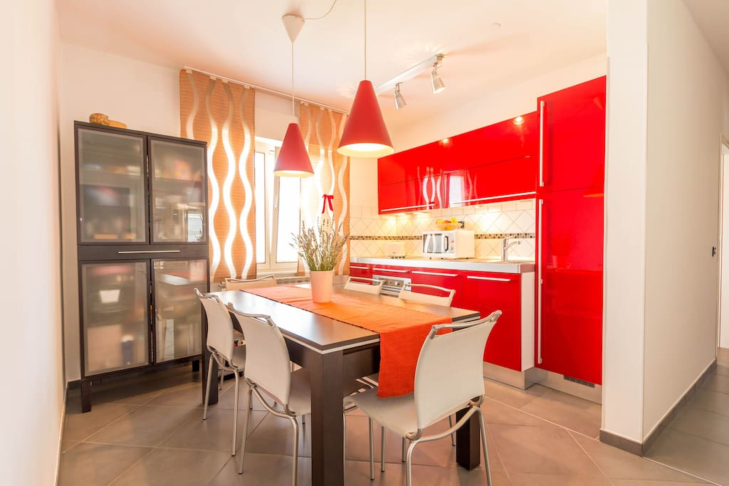 Kitchen equipment: electric stove (4 rings), oven, coffee machine, kettle, refrigirator with freezing compartment, toaster, extractor hood, cooking utensils