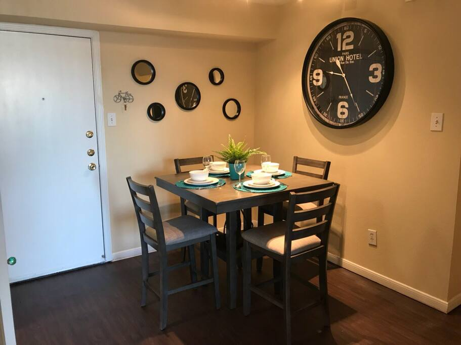 Dining table, set for four guests
