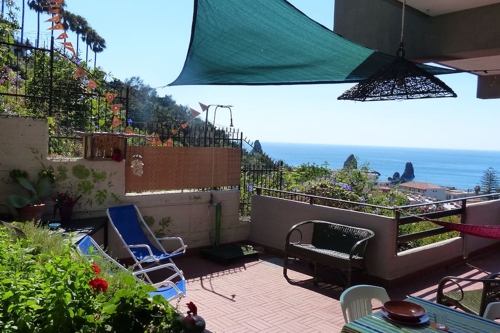 seaview and terrace with comfortable seats and additional outside shower!