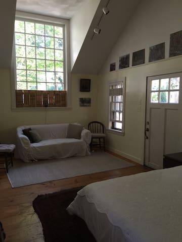 Studio bedroom with queen bed