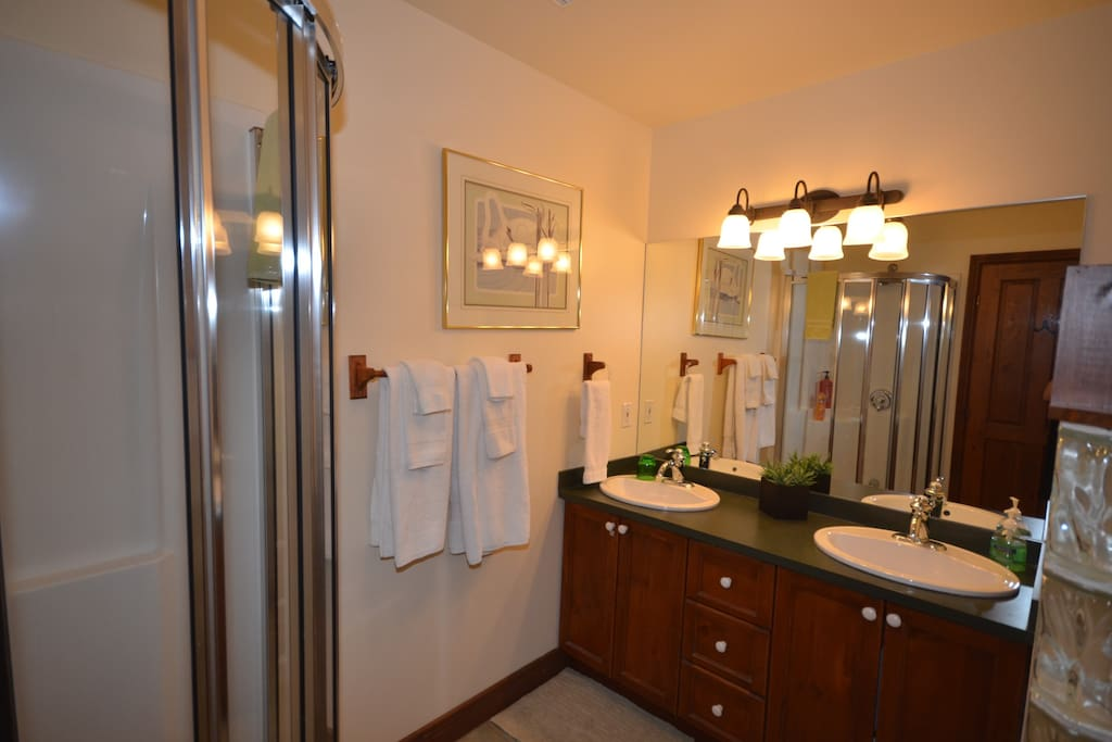 Large bathroom with two sinks and a shower