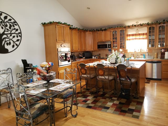 Large kitchen features microwave and large counter space.