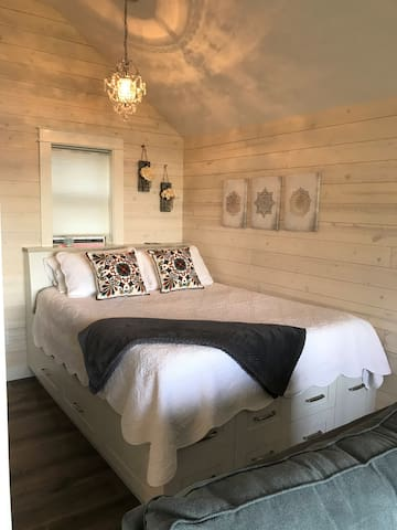 Enjoy the view from this queen size bed with custom built platform with plenty of drawers.