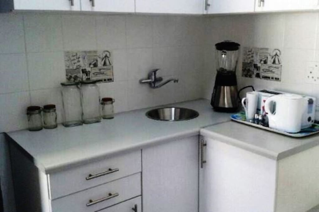 Compact kitchen with microwave and cutlery 2 plated stove