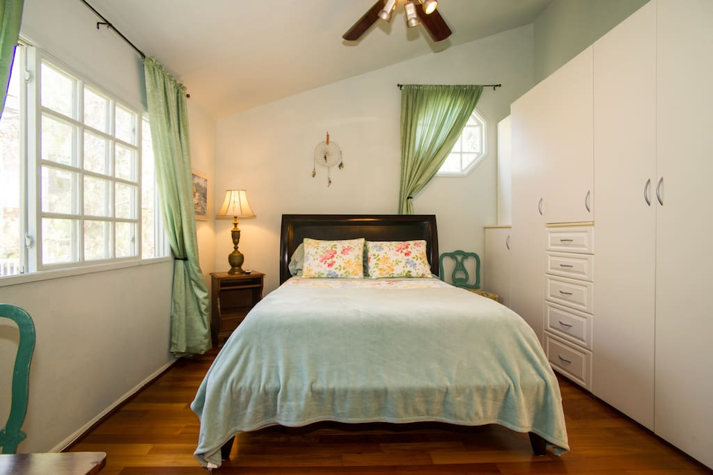 Cool sea breezes!  Airy bedroom fresh, clean and cozy with wooden floor. (Bed is 7ft x 5ft)