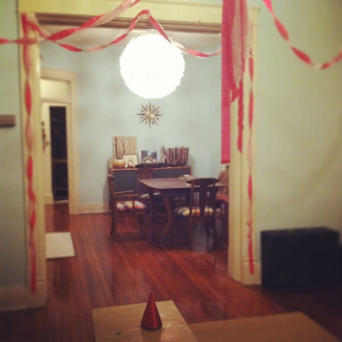 View of dining room through living room, decorated for my birthday party.