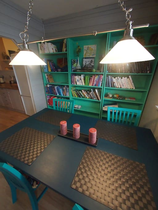 Cozy kitchen table area with a humble library