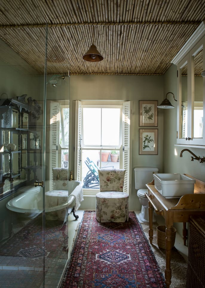 Old-world bathroom with a huge shower. Plenty of mountain water to bath in.