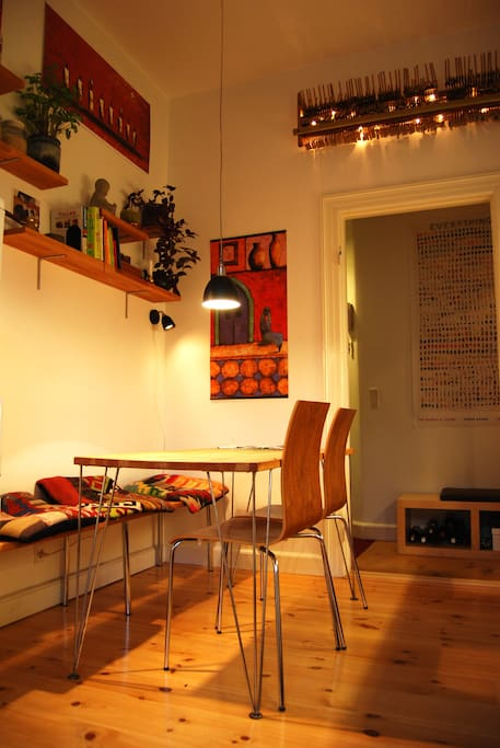 The cozy kitchen in my own design. I've put in a long bench, so there's is room for 5 at the table.