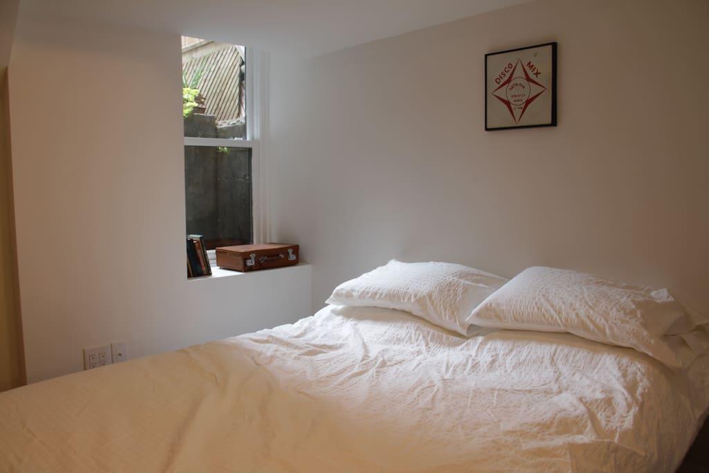 Cozy queen bed with memory foam pillow top