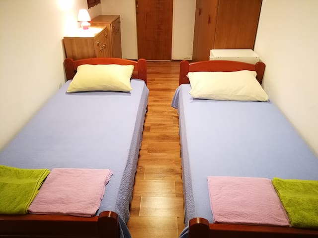 Second bedroom, with two separate beds