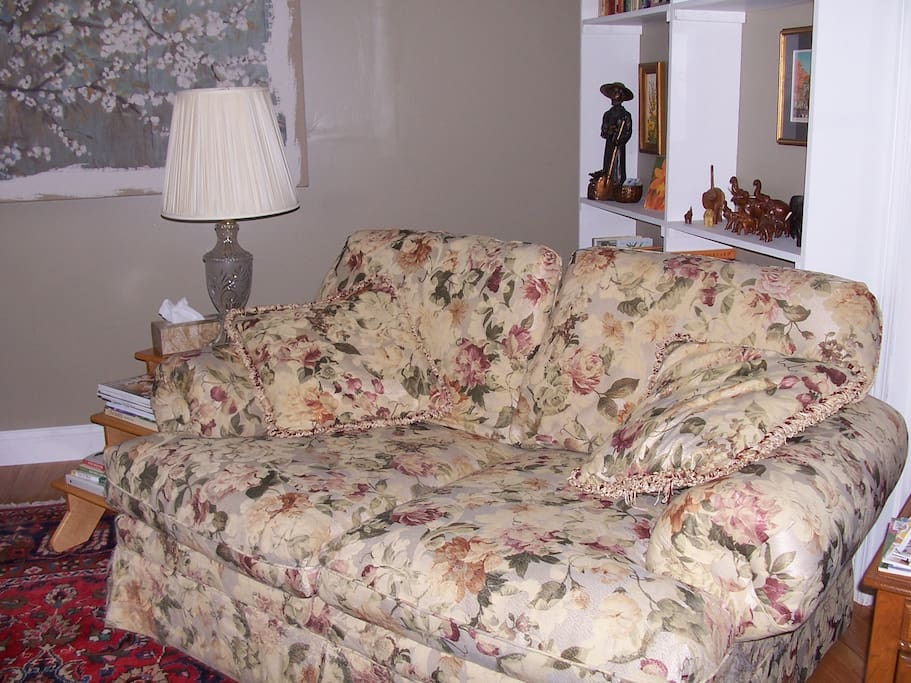 The living room has ample seating & this comfy sofa for TV viewing & conversation.