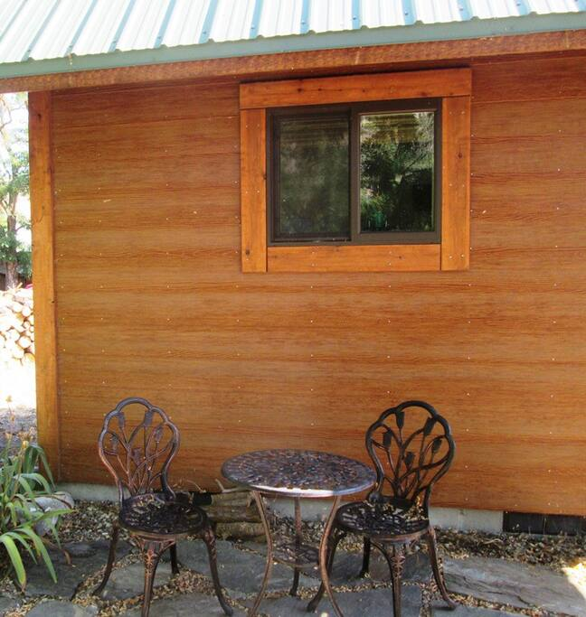 Small side patio for relaxing.  Also has a metal fire pit for cool evenings or making s'mores.