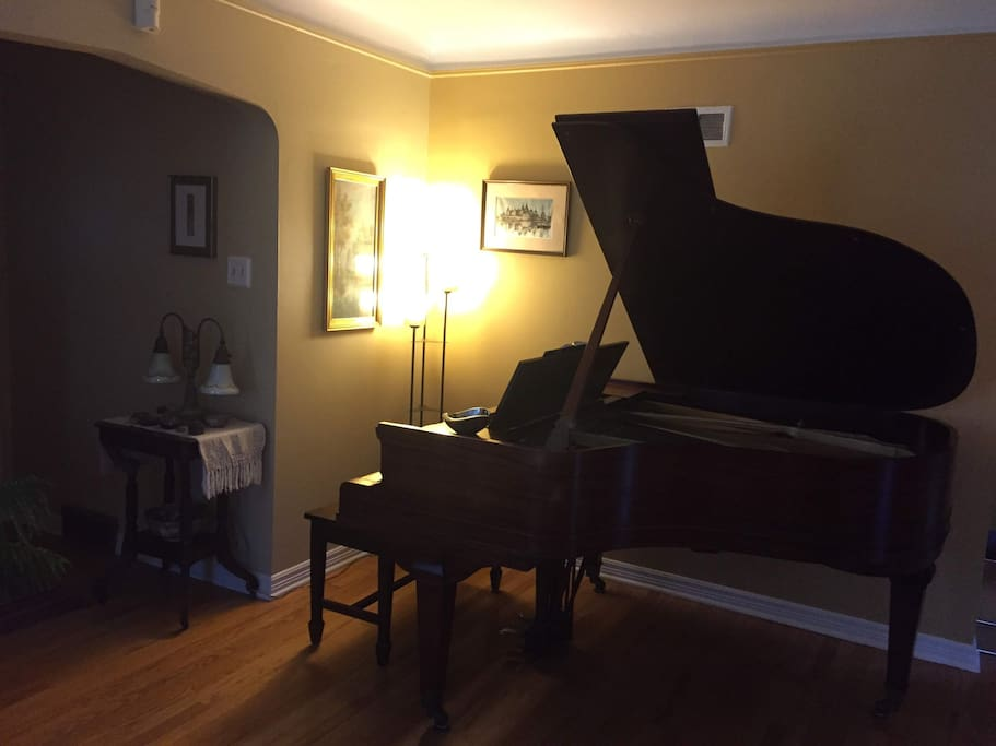 Grand piano in the living room for those who play.