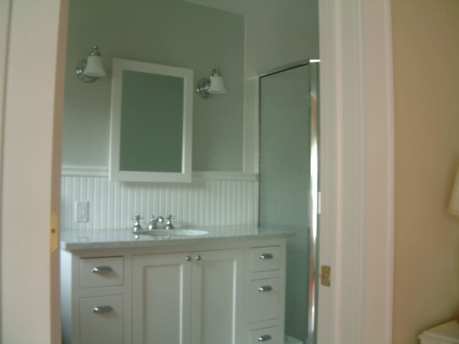 Master bath with shower and washer dryer