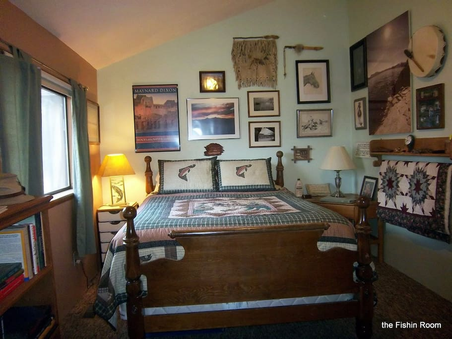 The Fishing Room has a queen bed and a love seat that is a twin hide-a-bed
