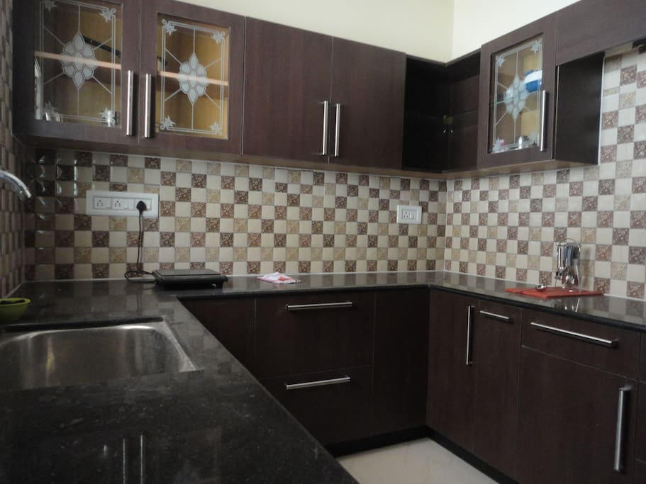 Kitchen with induction stove , rice cooker and other basic  utensils