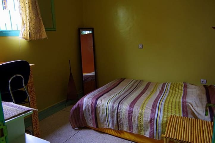 Double Bed Room with small Work space.