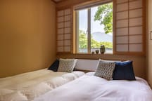 First bedroom, located on the first floor, with a gorgeous Mt. Yotei view within the comfort of your bedroom