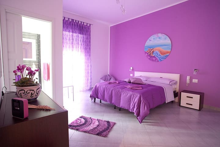 Camera in Appartamento con bagno privato e balcone