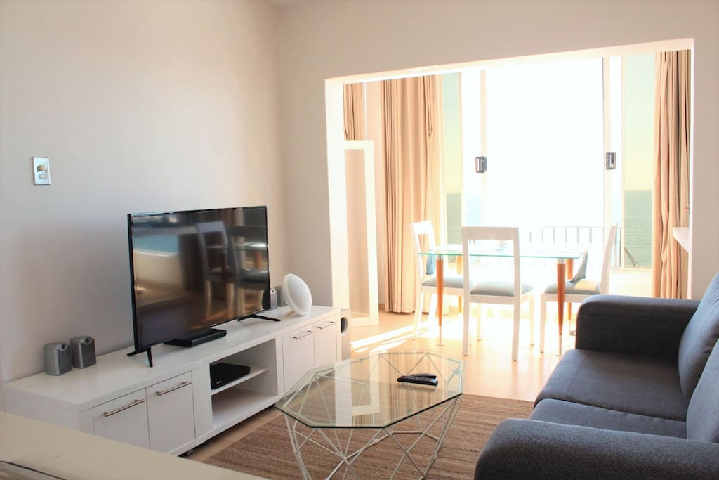 The living room is a story of light and relaxation. The TV is connected to the wifi and we have a netflix account set up. But you can freely stream any of your favourite channels.