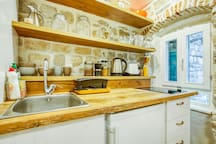 Fully-equipped kitchenette includes 2-burner stove, fridge, electric kettle, toaster and plenty of appliances (pots, frying pans, cutlery, utensils, mugs and dishes)