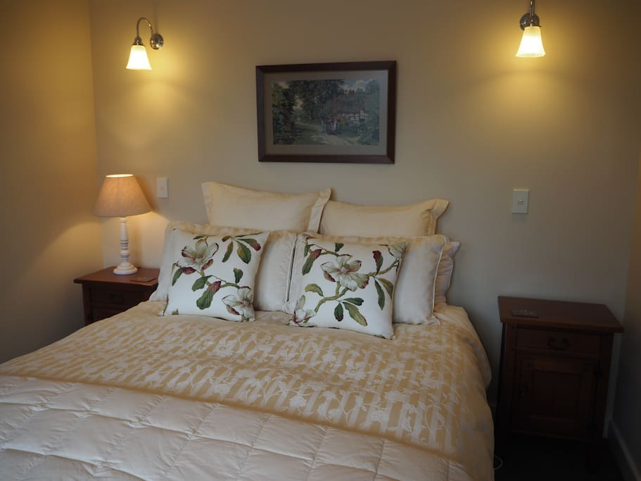 A very comfortable Queen bed with luxurious linen.