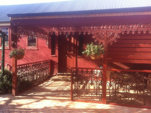 Front verandah resplendent with its original 1850 lacework