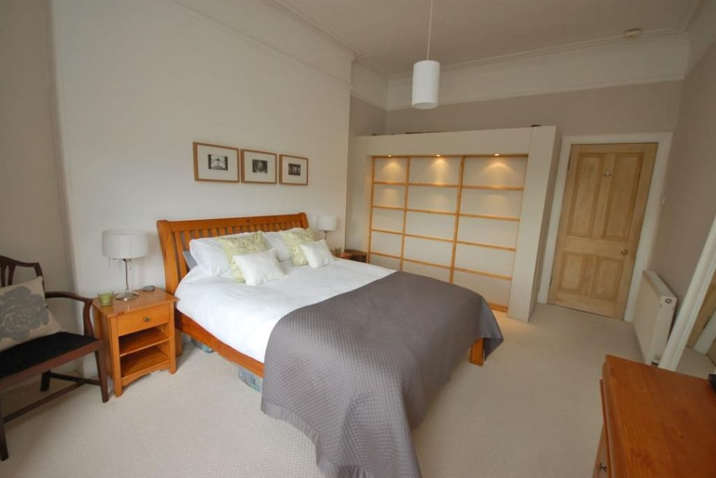 Double bedroom with large, stylish fitted wardrobe