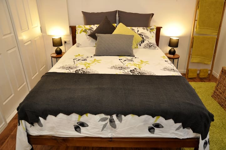 A comfortable queen bed awaits!