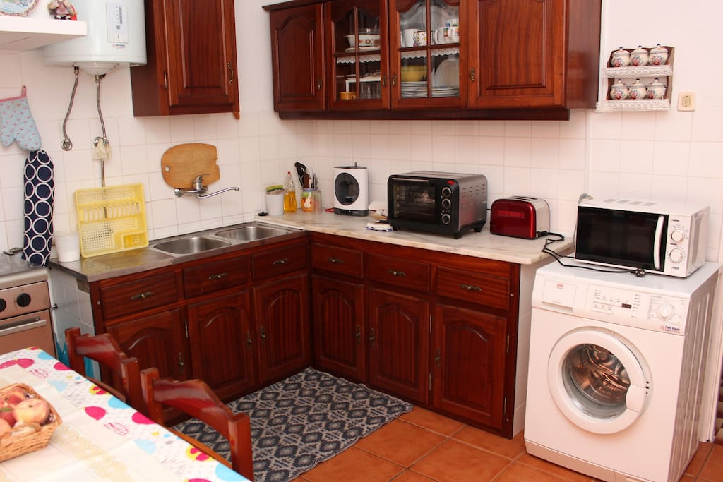 Kitchen with some amenities • Historic House in Downtown Peniche