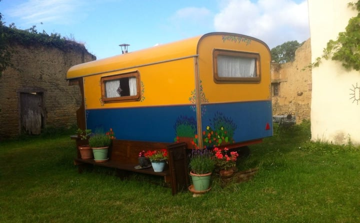 Gypsy caravan in walled garden