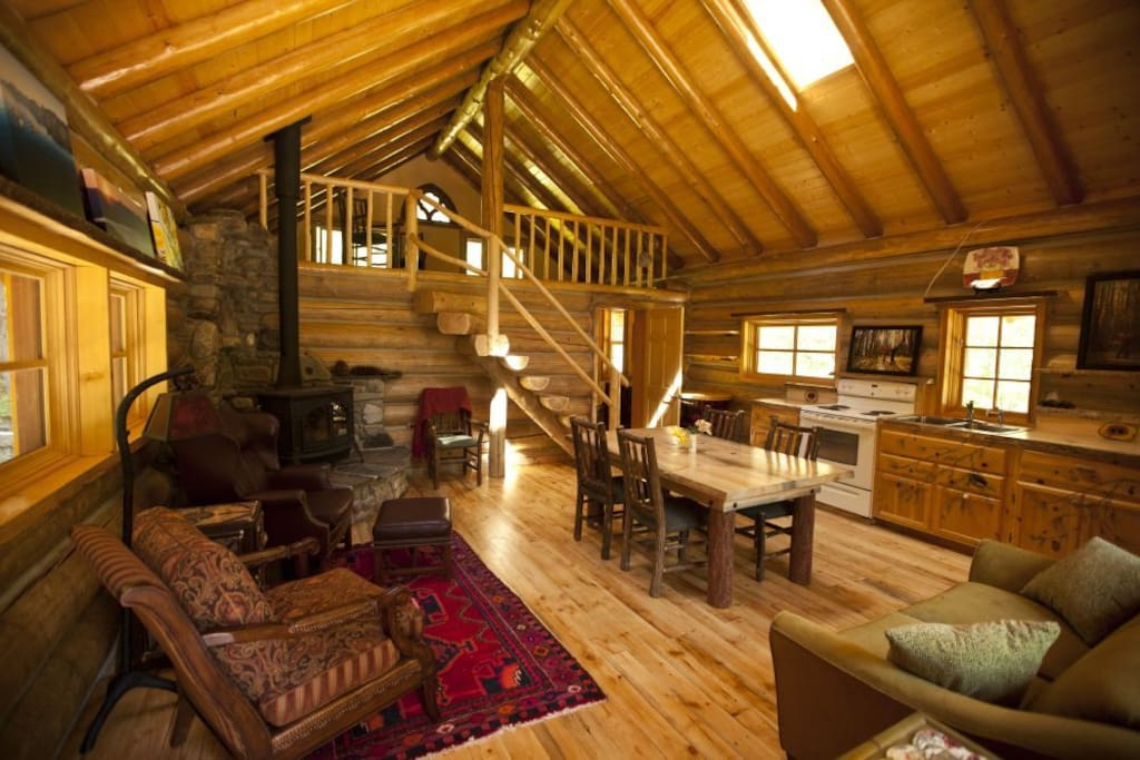 The interior of Starfire Cabin as you walk in the front door. The loft has two queen beds and can sleep 4.
