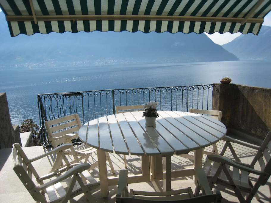 Casa Matteo features a gorgeous lakefront terrace which leads down to a grassed garden with direct water access via ladder to a shoreline jetty opposite the island of Isola Comacina
