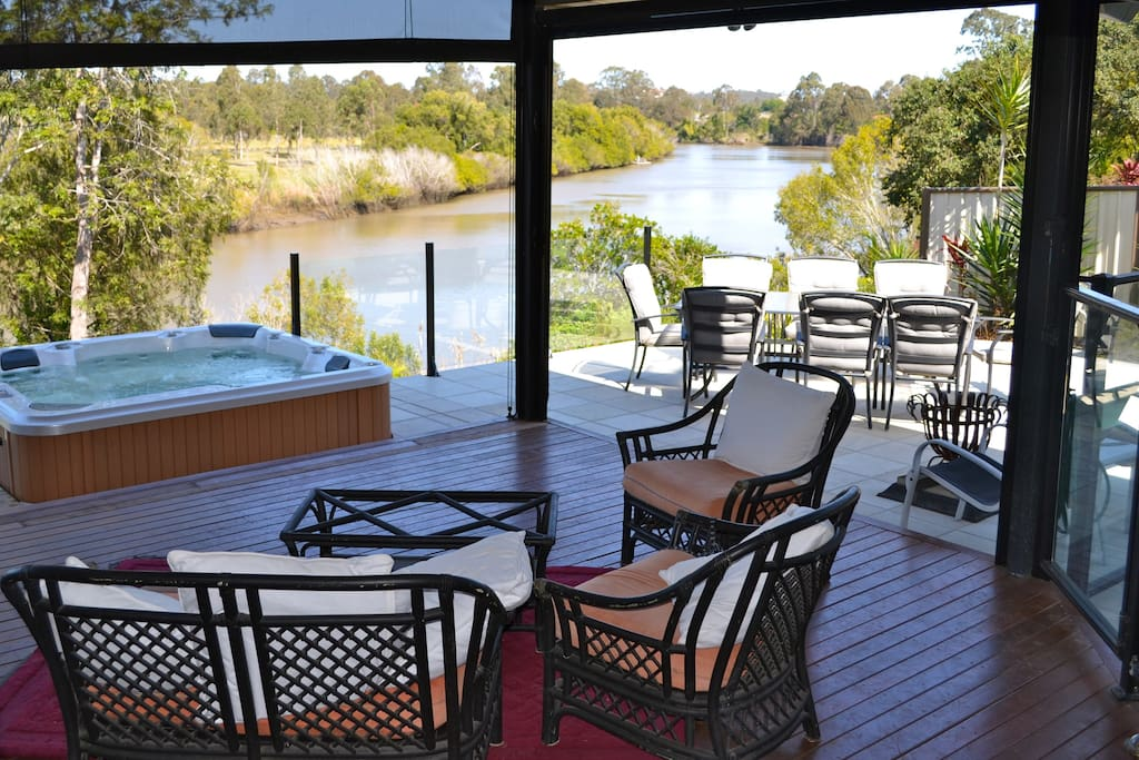 The view of the river and spa from the deck. Spa is always kept at 38 degrees! :)
