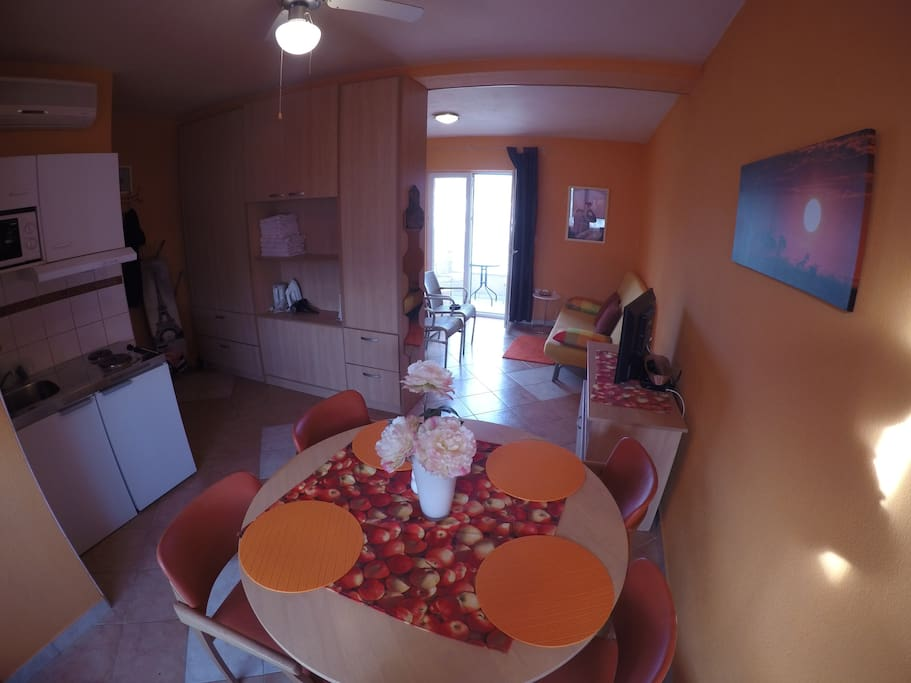 Nice and sweet living room with small kitchen with everything you need for preparing a nice meal.
