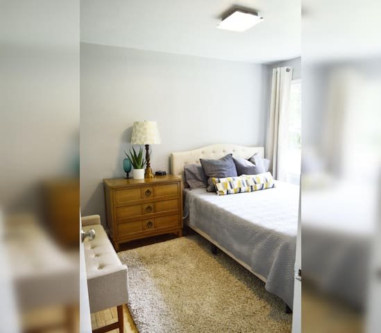 Bedroom #1 with queen bed; night stand a clock w/ USB and outlets to make charging devices super convenient