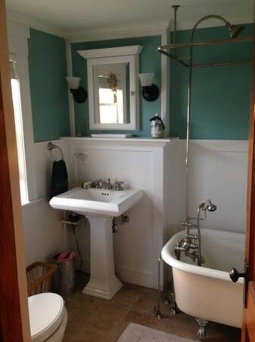 Renovated bathroom with original bear-claw tub / shower
