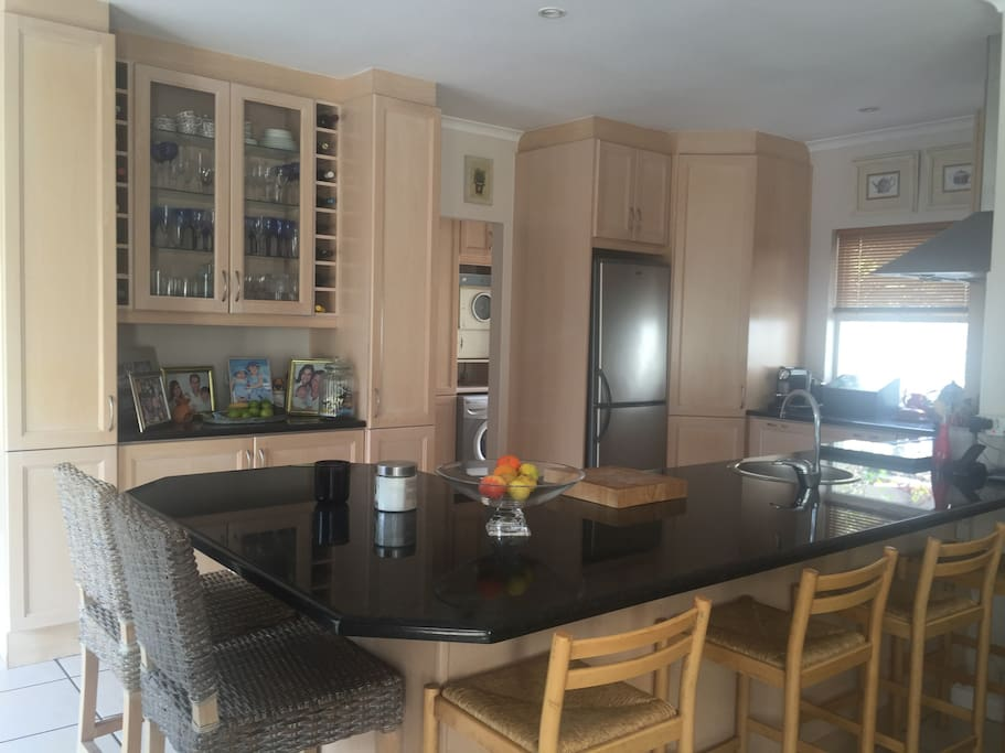 The open plan kitchen to TV room