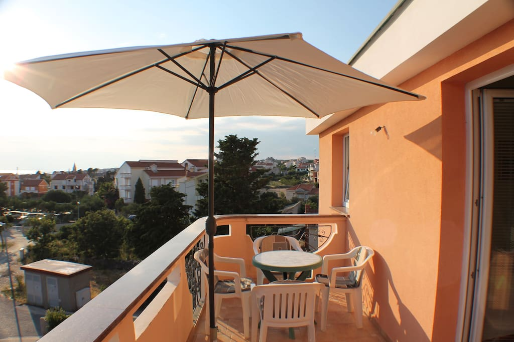 Large sunny terrace with great view.