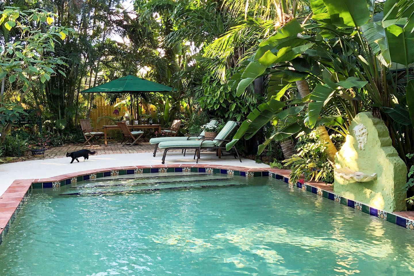 Set in a palm-shaded jungle, historic Flamingo Bungalow is close to beaches and downtown West Palm Beach, but feels worlds away.