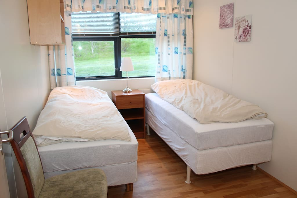 Two single beds in the other bedroom