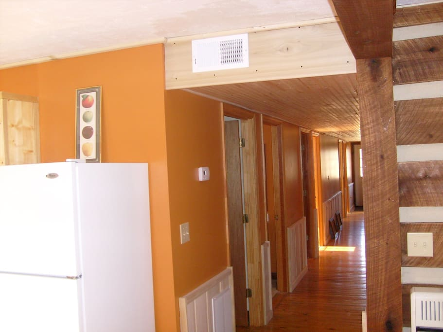 Utility room, bathrooms, and bedrooms open on this hall.