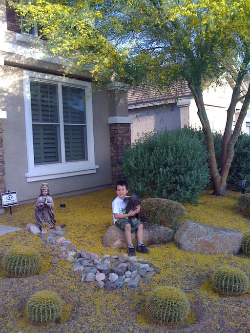 Noah & Chico in the front yard!