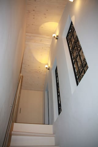 The stairs to the bedroom on the first floor