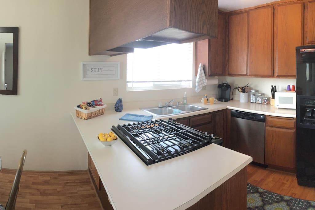Kitchen fully equipped with dishes, pans, appliances, including Keurig coffee maker