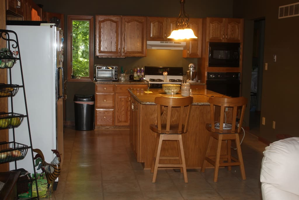 Full kitchen with island and gas stove.